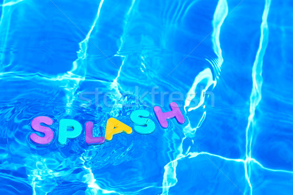 Word SPLASH floating in a swimming pool Stock photo © RTimages