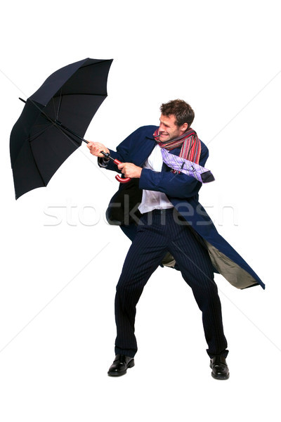 Businessman struggling with umbrella Stock photo © RTimages