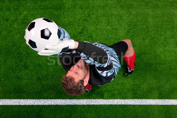 Erschossen Torhüter Speichern Ball Luft Foto Stock foto © RTimages