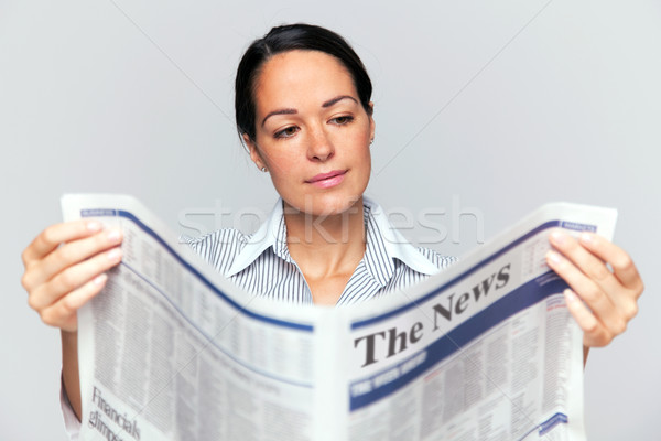 Stock photo: Businesswoman reading a newspaper