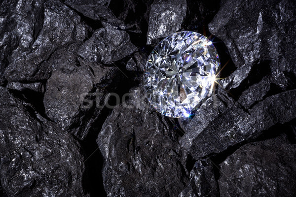 Stock photo: Diamong amongst Coal