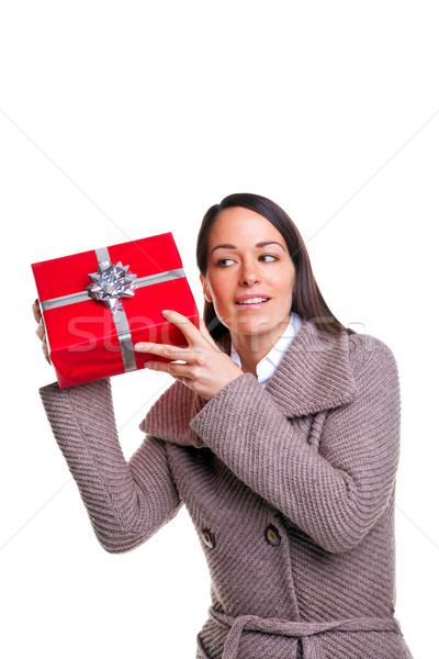 Woman shaking her present Stock photo © RTimages