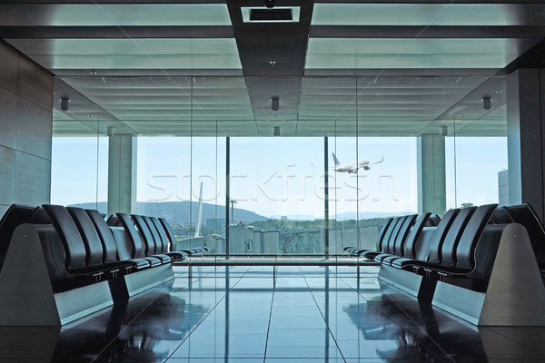 Modern airport departure lounge with plane taking off Stock photo © RTimages