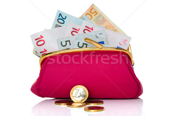 Purse full of money isolated on white Stock photo © RTimages