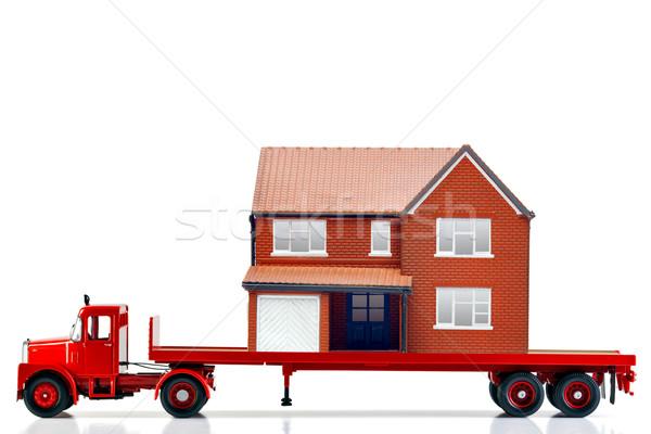 Déplacement maison maison isolé blanche Photo stock © RTimages