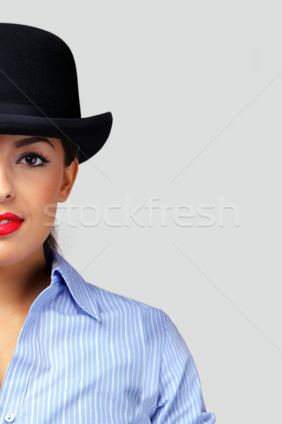 Businesswoman wearing a bowler hat. Stock photo © RTimages