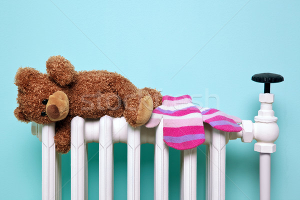 Teddy bear and gloves on an old radiator Stock photo © RTimages