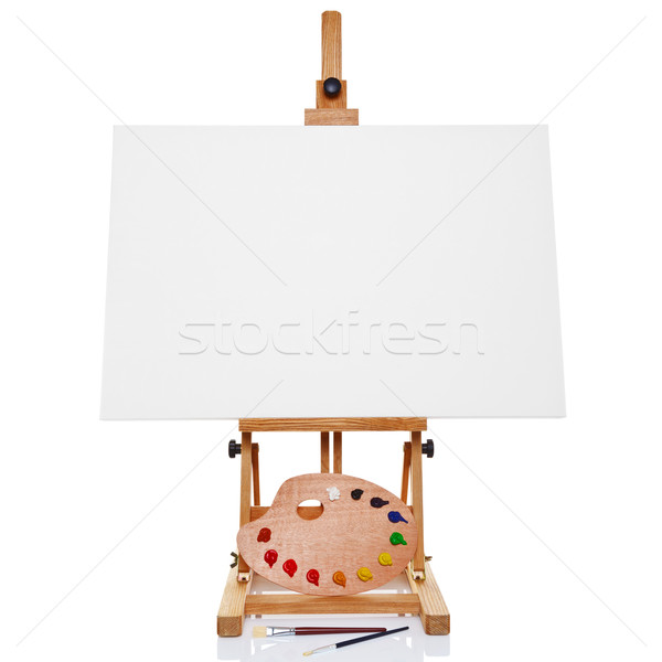 Easel with blank canvas palette paint and brushes isolated on wh Stock photo © RTimages