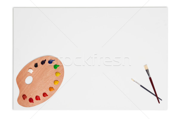 Blank canvas brushes and paint palette isolated on white Stock photo © RTimages