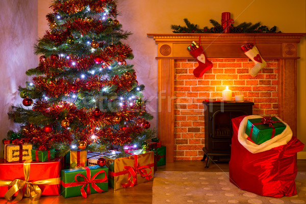 A Living room on Christmas Eve with tree and gifts Stock photo © RTimages