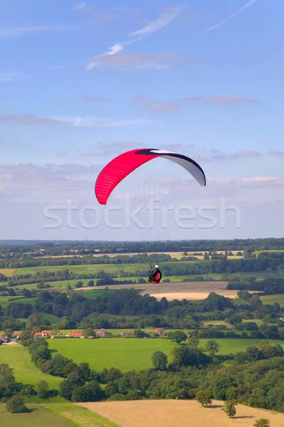 Piros fehér repülés vidéki táj férfi tájkép Stock fotó © RTimages