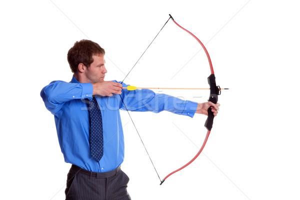 бизнесмен лук стрелка вид сбоку изолированный белый Сток-фото © RTimages