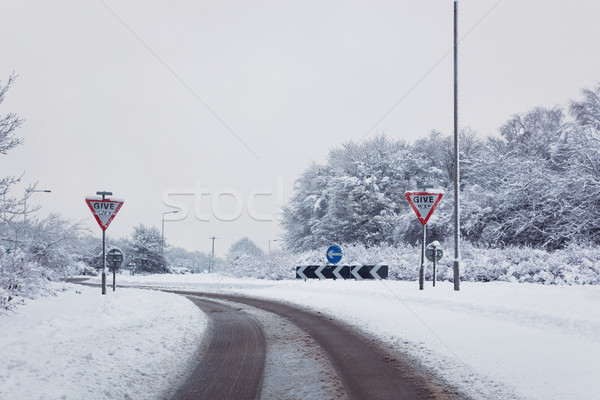 Road with give way signs in the snow Stock photo © RTimages