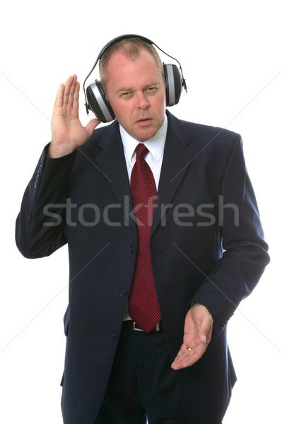 Businessman in earphones Stock photo © RTimages
