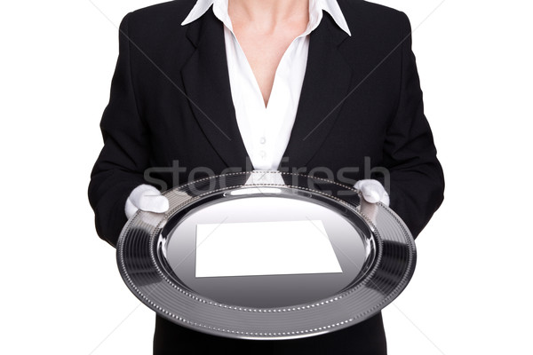 Female butler holding a silver tray isolated on white. Stock photo © RTimages