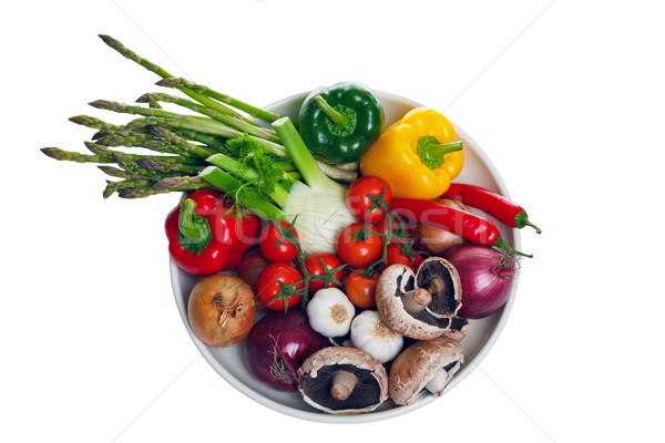 Bowl of vegetables from above isolated on white. Stock photo © RTimages