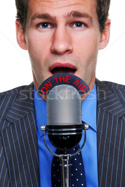 Stock fotó: üzletember · levegő · mikrofon · közelkép · portré · beszél
