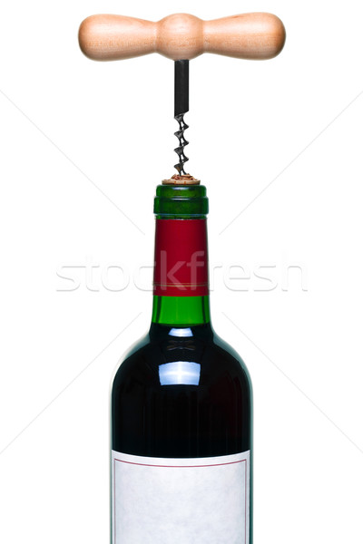 Stock photo: Red wine bottle and corkscrew isolated
