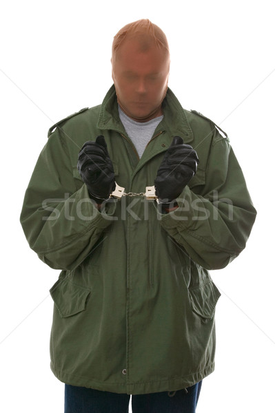 Robber in handcuffs Stock photo © RTimages