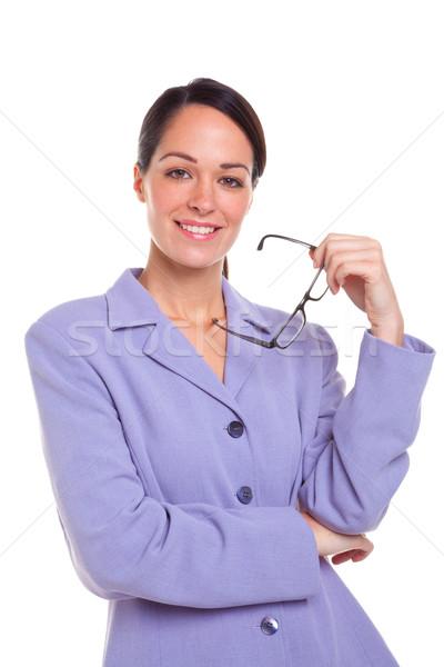 Vonzó üzletasszony tart szemüveg portré mosolyog Stock fotó © RTimages