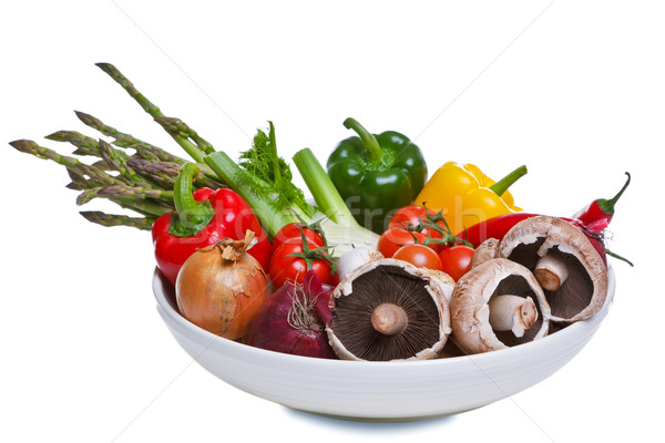 Stock photo: Bowl of vegetables isolated on white.