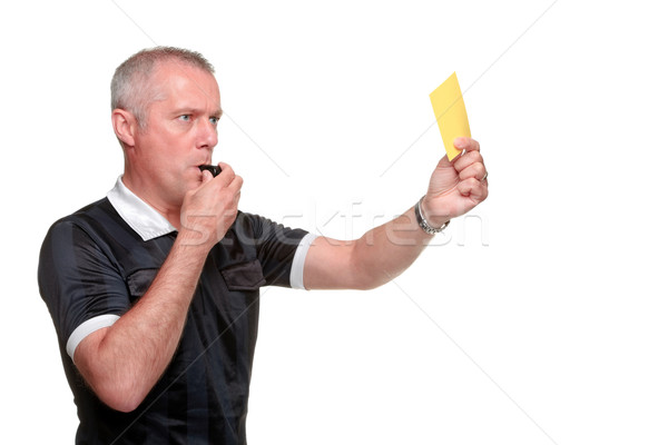 Referee showing the yellow card side profile Stock photo © RTimages