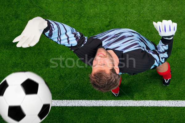 Overhead shot of a goalkeeper missing the ball. Stock photo © RTimages