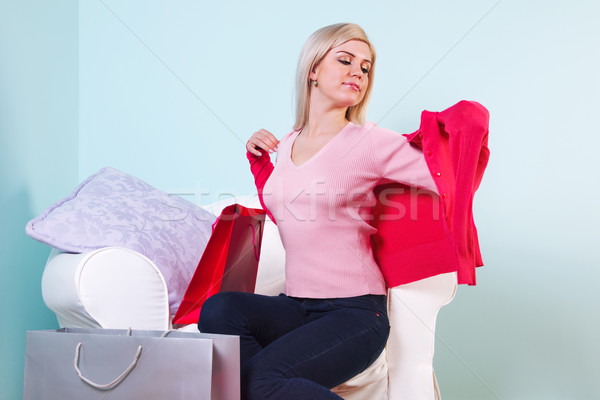 Woman trying on new clothes she just bought Stock photo © RTimages