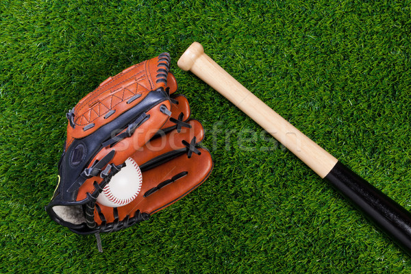 Baseball glove bat and ball on grass Stock photo © RTimages