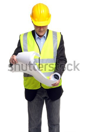 Building contractor in safety gear with plans Stock photo © RTimages