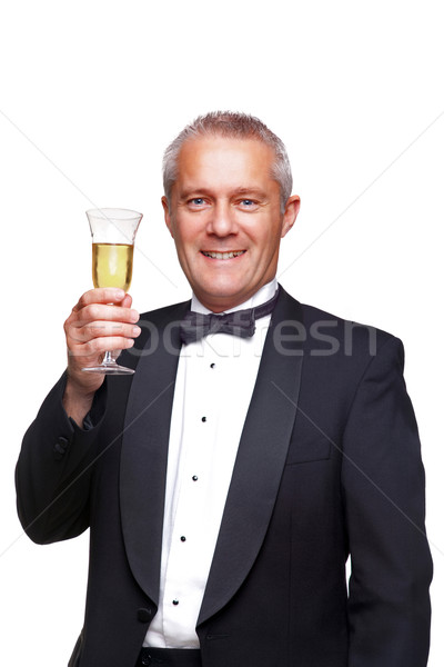 Man in tuxedo toasting with champagne. Stock photo © RTimages