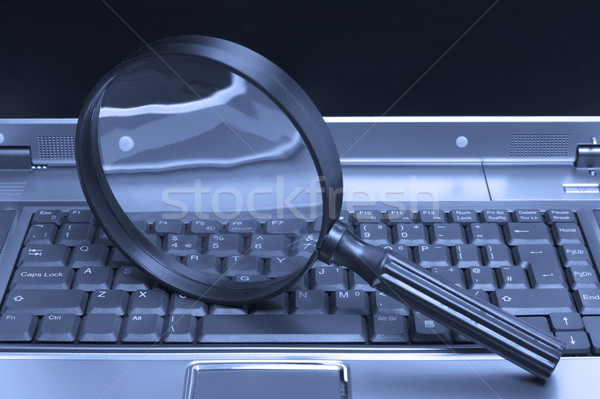 Laptop Magnifying glass Stock photo © RTimages