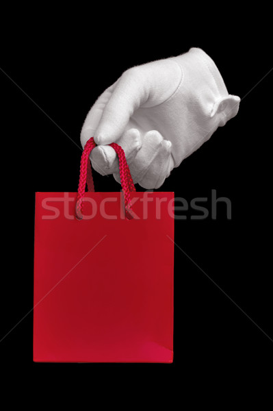 White glove holding red shopping bag Stock photo © RTimages