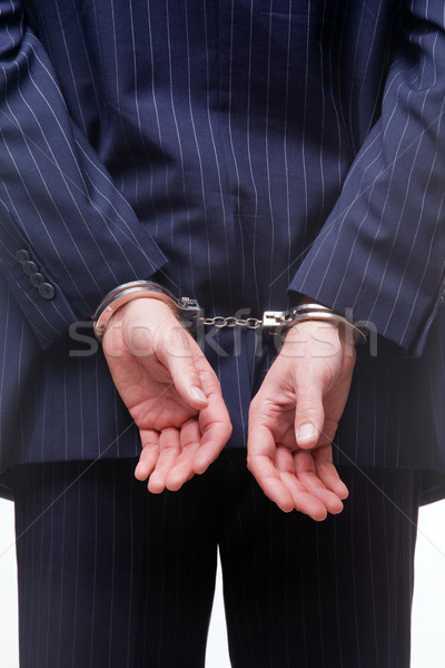 Businessman in handcuffs Stock photo © RTimages