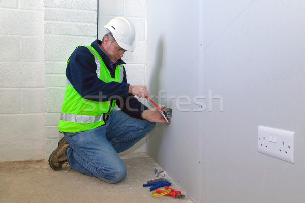 Stock photo: Electrician at work