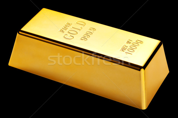 Gold bar isolated on black Stock photo © RTimages