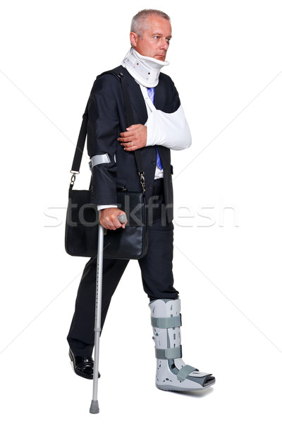 Injred businessman on crutches isolated on white Stock photo © RTimages