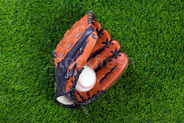 Baseball glove and ball on grass Stock photo © RTimages
