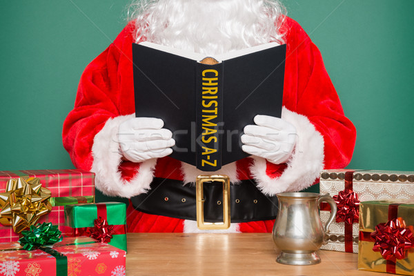 Santa reading Christmas A-Z Stock photo © RTimages