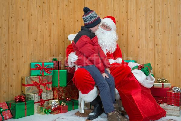 Boy visiting santas grotto Stock photo © RTimages