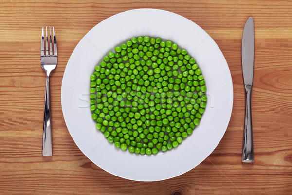 Peas on a white plate Stock photo © RTimages