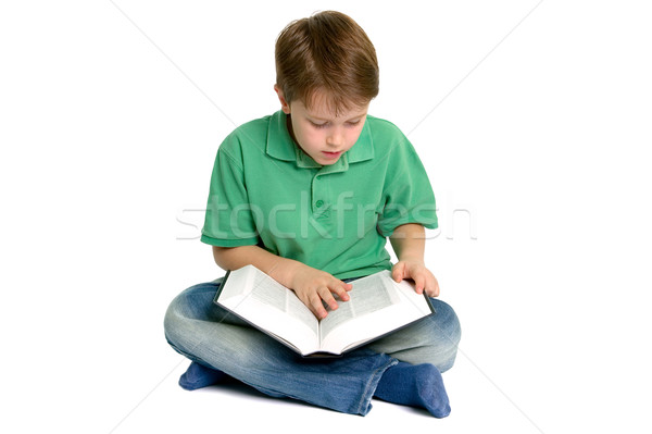 Boy reading crossed legs Stock photo © RTimages