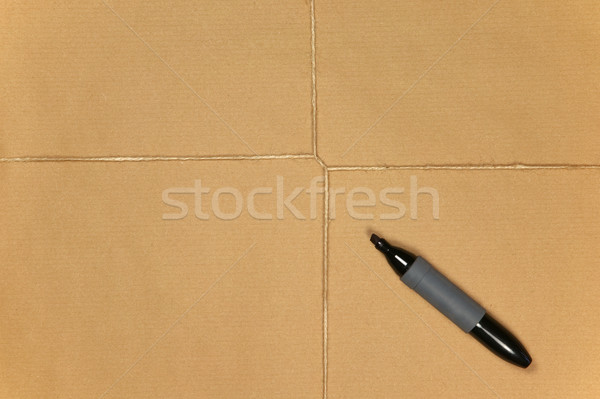 Brown paper parcel tied up with string and pen. Stock photo © RTimages