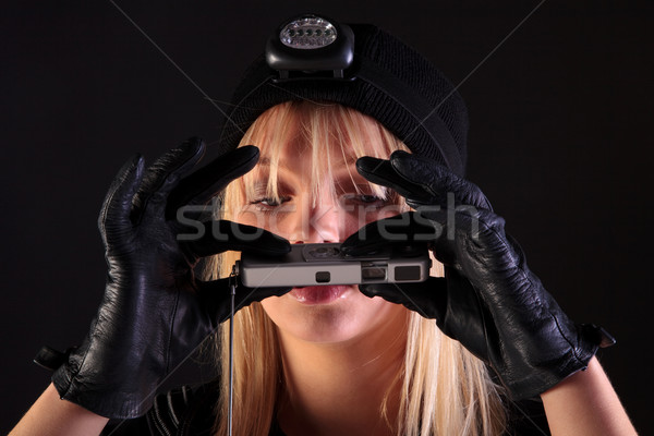 женщину кошки грабитель шпиона камеры Сток-фото © RTimages