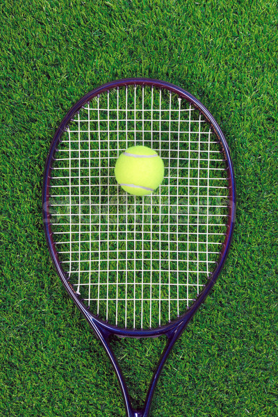 Tennis raquet and ball on grass Stock photo © RTimages