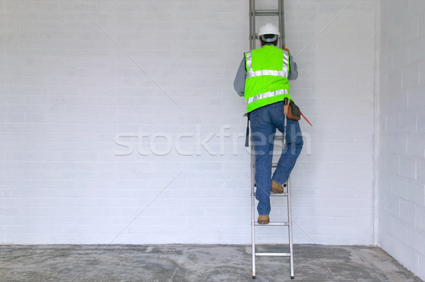 Workman climbing a ladder Stock photo © RTimages