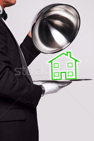 Stock photo: Butler serving a new home