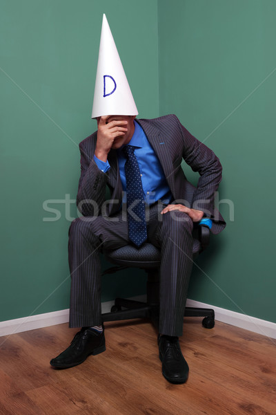 Businessman wearing a dunce hat Stock photo © RTimages
