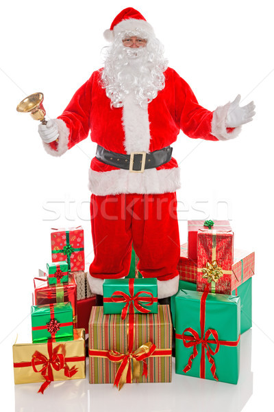 Father Christmas surrounded by presents, isolated on white. Stock photo © RTimages