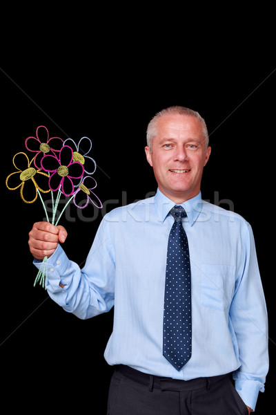 Businessman holding chalk drawn flowers Stock photo © RTimages